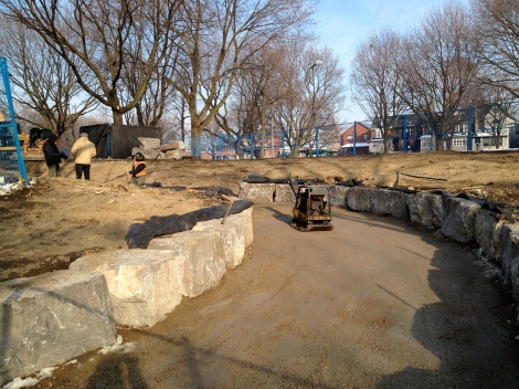 Limestone boulders continue to be placed along sides of ramp