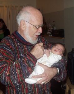 Gordon McClure with a grandchild