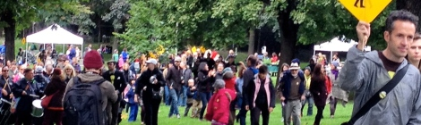 Jode Roberts of DSF leading a crowd through Fred Hamilton Park