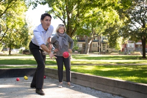 Liberal leader Justin Trudeau plays a game of bocce during a campaign stop in Fred Hamilton Park in Toronto, Monday, Sept. 14, 2015. THE CANADIAN PRESS/Jonathan Hayward