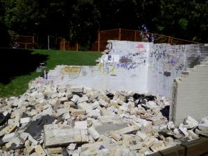 """Former """"field house"""" demolished, clearing the hillside for park activities."""