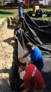Lining the pit with a waterproof membrane. From top: Frank Nguyen, Valentin Signol, Dinu Filip, Jon Donaldson.