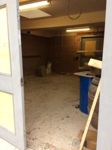 Peering inside the building on Jan 20th - Kitchen area with double doors in background